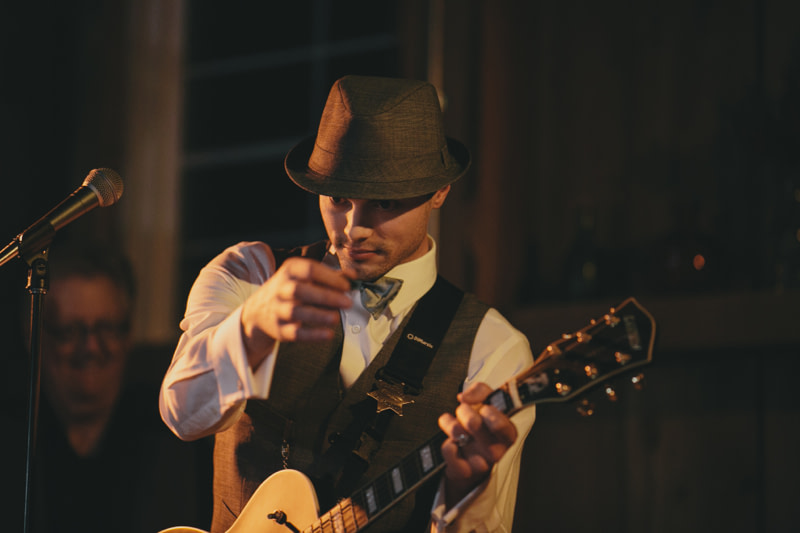 groom playing guitar